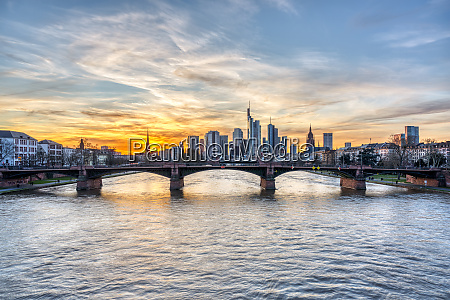 dramatic sunset over downtown frankfurt and