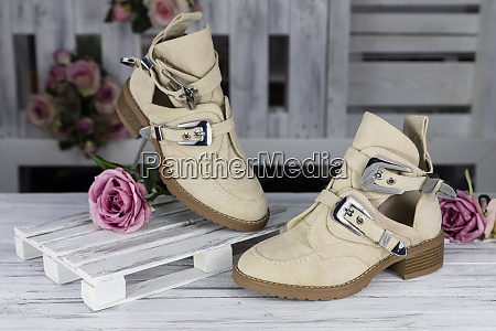 female leather shoes on rustic wooden