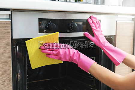 woman hands in protective gloves cleaning