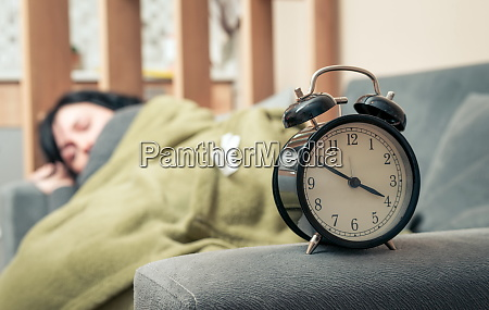 alarm clock and the woman