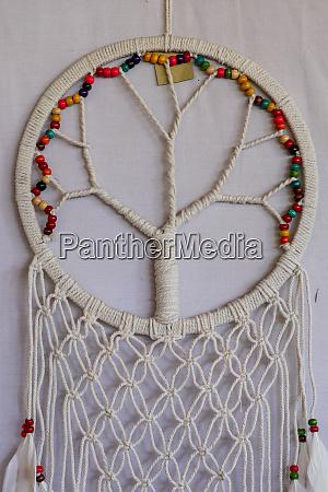white dreamcatcher indian amulet that