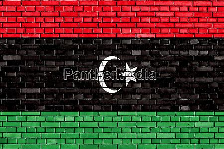 flag of libya painted on brick