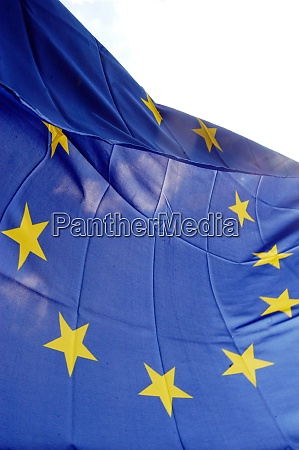 sun shining on eu flag