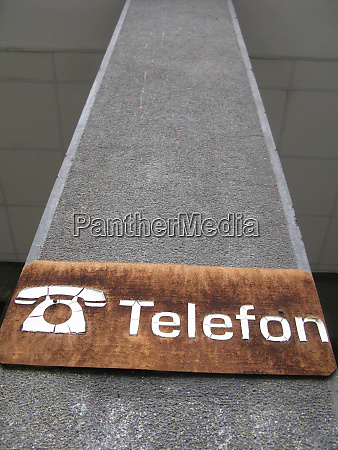 landline telephone symbol white brown background