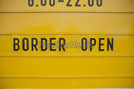 yellow border open sign eu