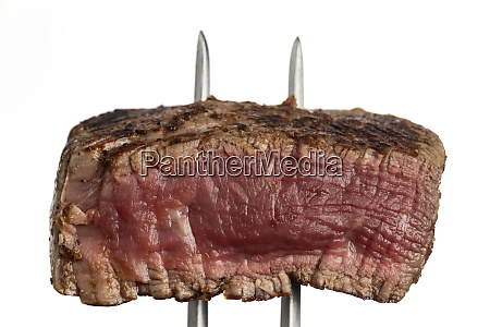 grilled steak on a meat fork