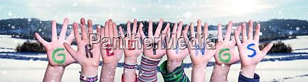 children hands building word greetings snowy