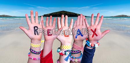 children hands building word relax ocean