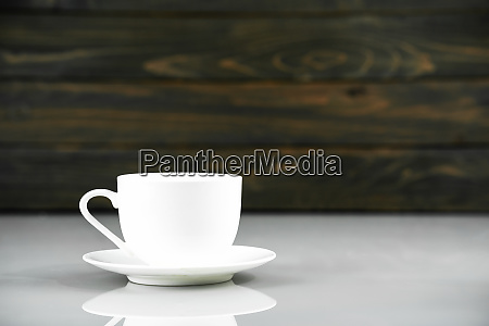 coffee cup on table with wood