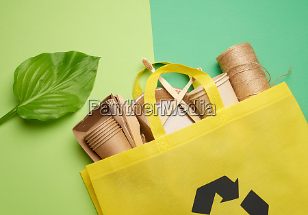 yellow textile bag and disposable tableware