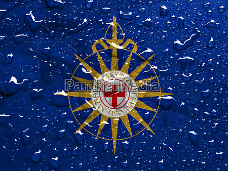 flag of anglican communion with rain