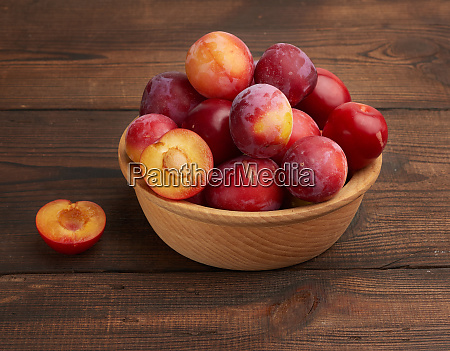ripe red plums in a round