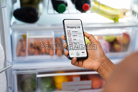 african consumer using phone shopping app