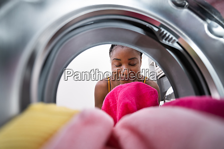 smelling washed clothes or laundry
