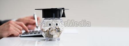 piggy bank college graduate cap