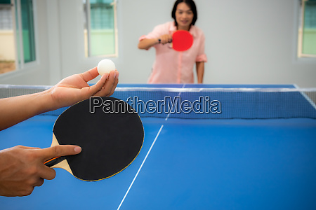 woman playing table tennis stay at