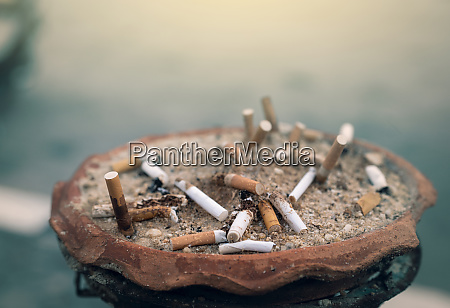 ashtray full of cigarette butts used