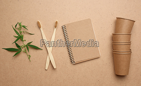 disposable brown paper cups notepad and