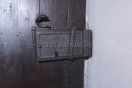 old door lock on a wooden