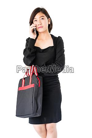 woman carrying a black shopping bag