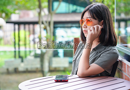 woman sitting in cafe terrace
