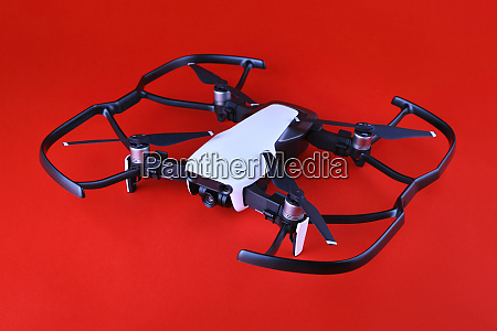 uav drone copter isolated on red
