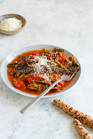 healthy sauteed green cicory and tomatoes