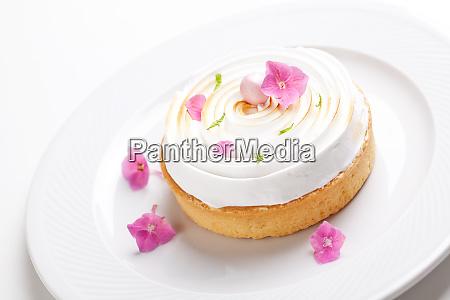 gourmet lemon pie with edible flowers