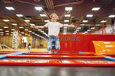 girl jumping on trampoline in entertainment