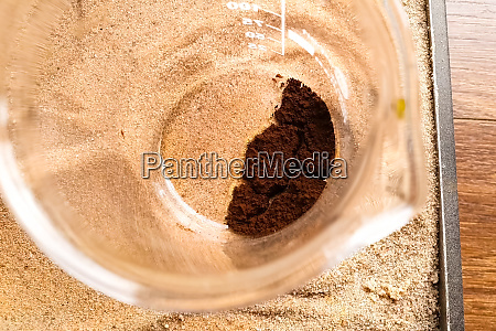 brown slag in glass cup chemical