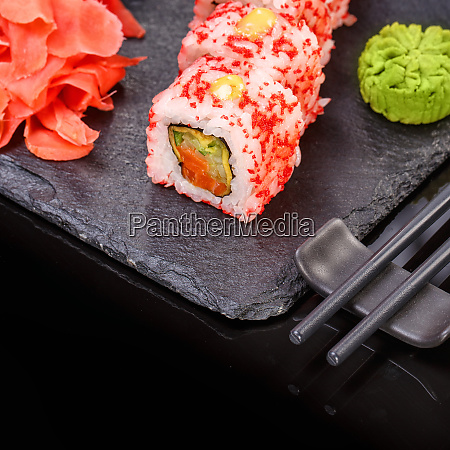 sushi roll with seafood and soy