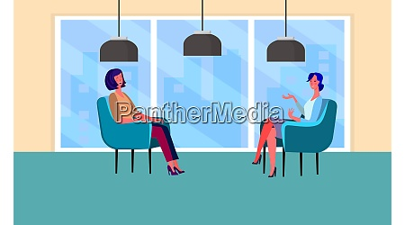 two females are sitting in office