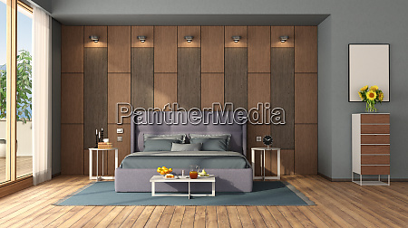 modern bedroom with double bed against