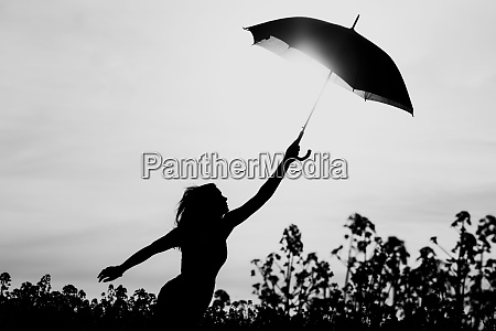 unplugged free silhouette woman umbrella up