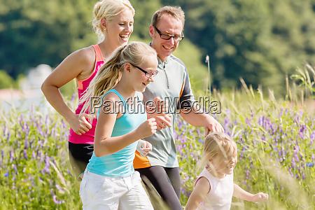 family sport running through field