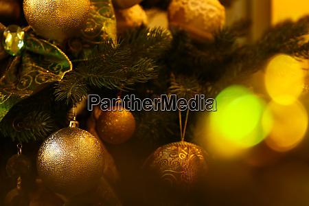 close up christmas tree decorations hanging