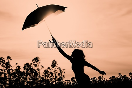 unplugged free silhouette woman with umbrella