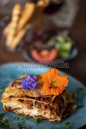 lasagna on a blue plate