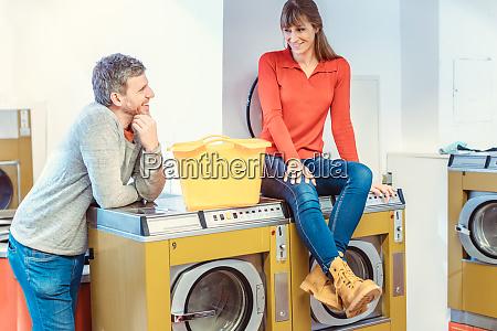 couple talking in laundromat