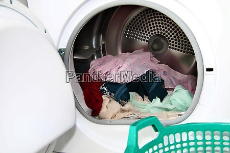 view clothes inside dryer with open