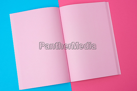 open notebook with blank pink pages