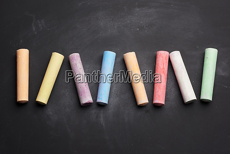 multicolored chalk on lie on empty