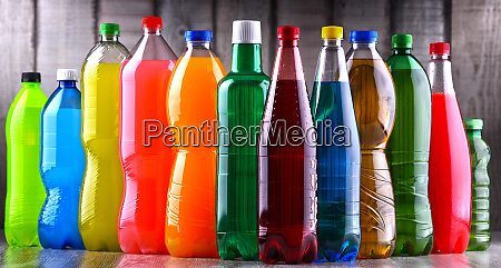 plastic bottles of assorted carbonated soft