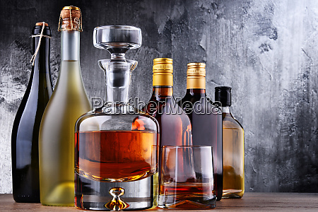 carafe and bottles of assorted alcoholic