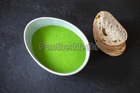 creamy, pea, soup, on, black, slate - 28682415