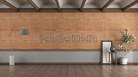 empty room with brick wall and