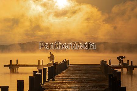 bathing during sunrise at lake woerthsee