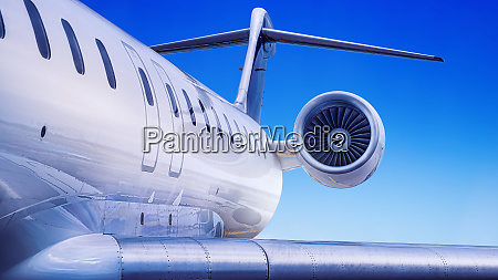private jet against a blue sky