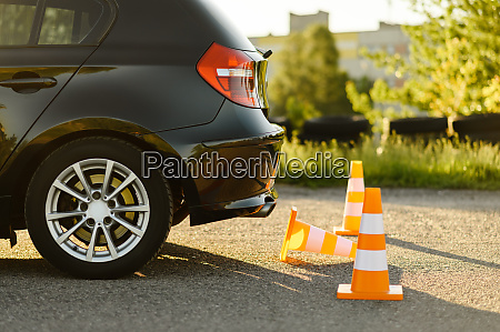 car and traffic cones driving school