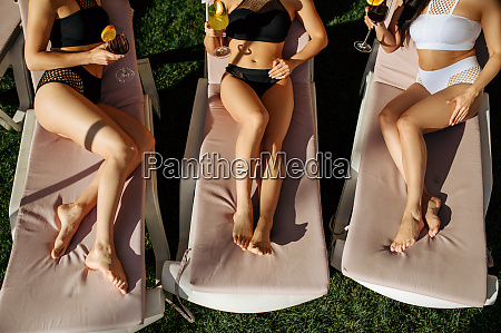 female persons with coctails leisures on